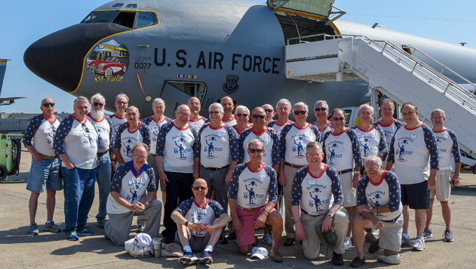 vietnam veterans pose in front of a kc-135 aircraft