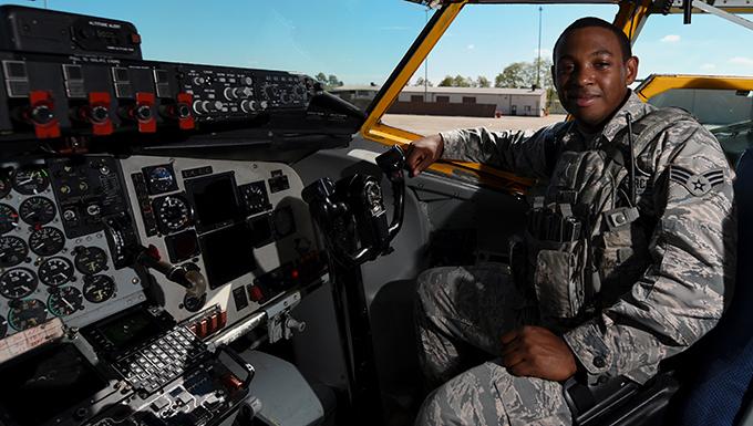 Senior Airman Vega sitting in the cockpit